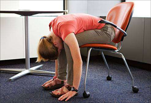 DailyMedicalinfo13 photo of teen doing chair stretch at desk1