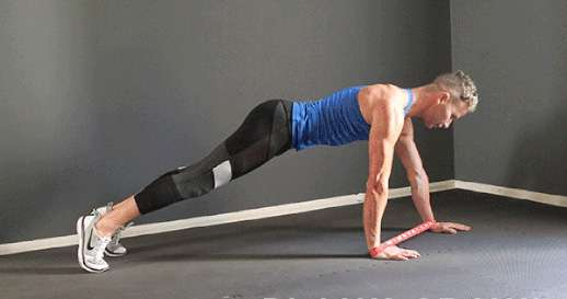 تمرين Plank Crawl with Mini Band